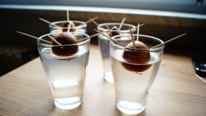Avocado seeds on glass with water