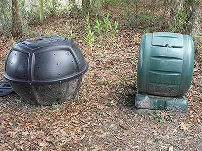 compost tumbling bins in the garden