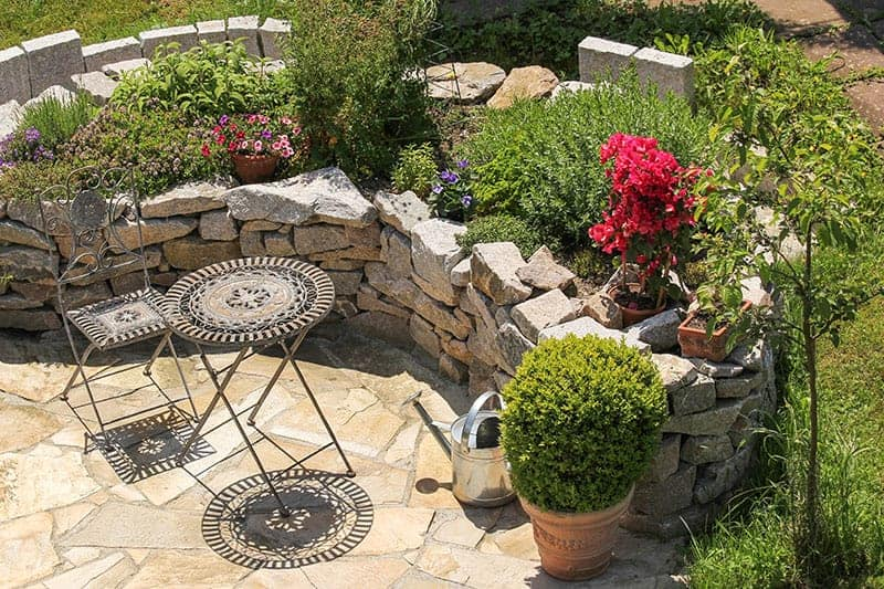 Flower beds and garden furniture